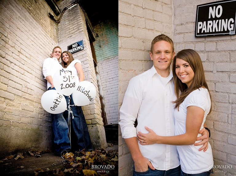 Couple poses with engagement announcement balloons