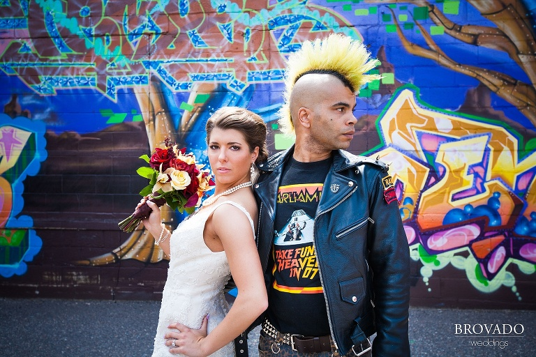 bride poses with a punk man with a mohawk