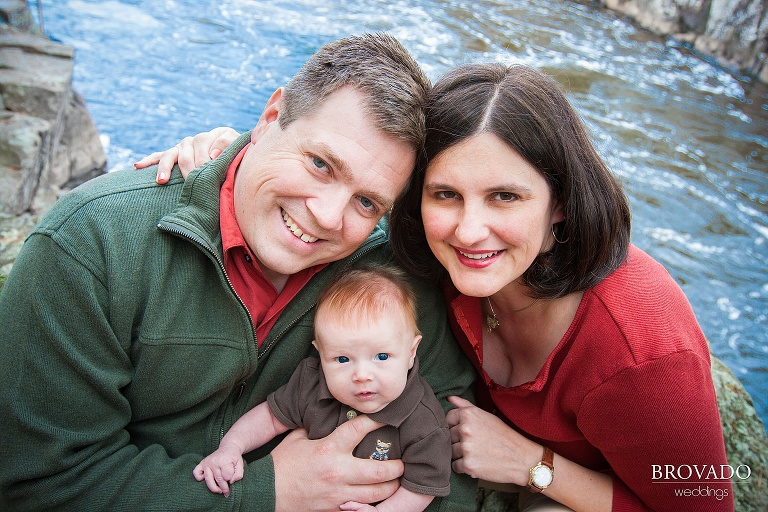 newborn family portrait overlooking the river