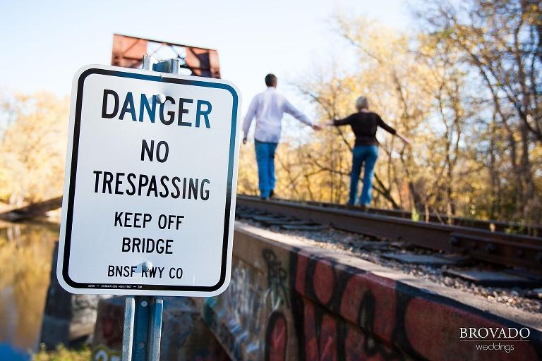 couple walk across railroad tracks