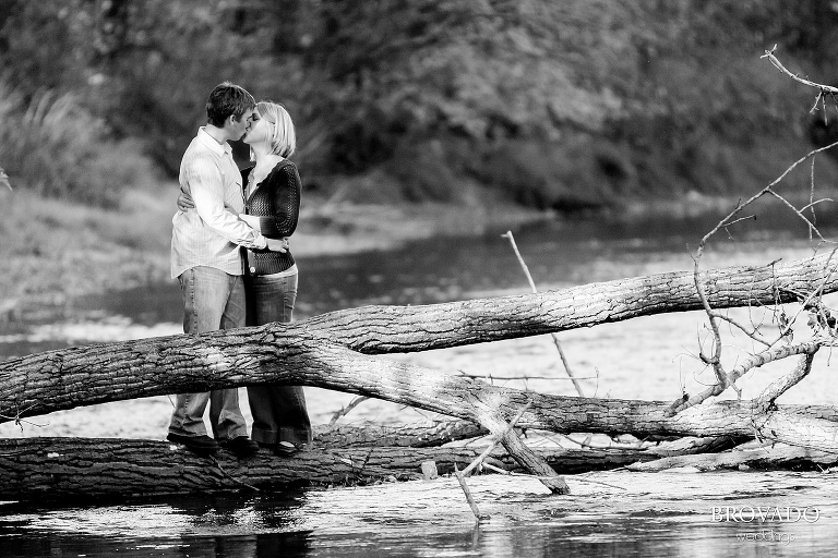 dramatic black and white kiss over the river