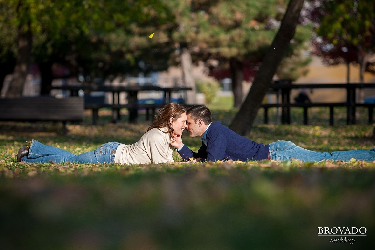 couple kiss in the fall leaves
