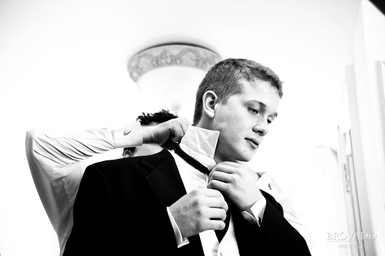 groom getting help with his tie