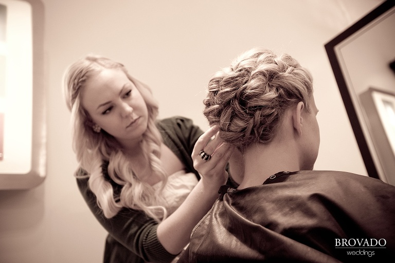 close-up wedding photography of bride getting her hair done