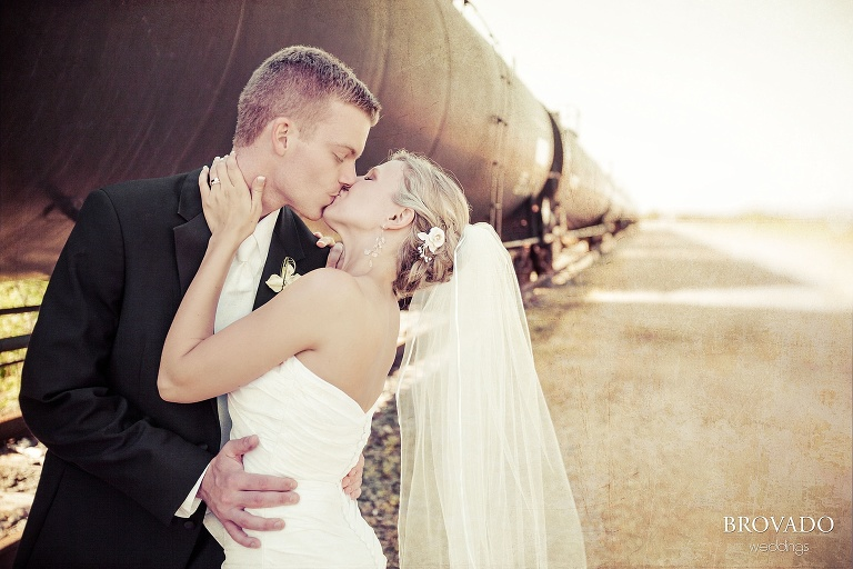 sepia wedding photography in front of a train