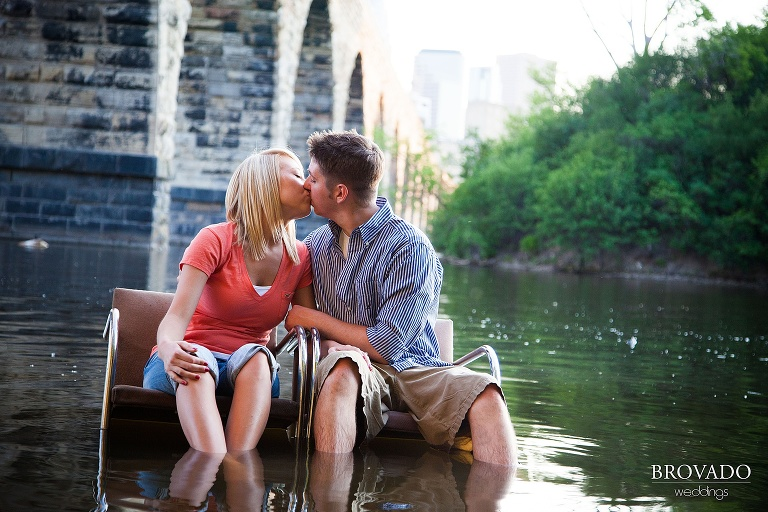 engagement photography of couple sitting in mississippi river