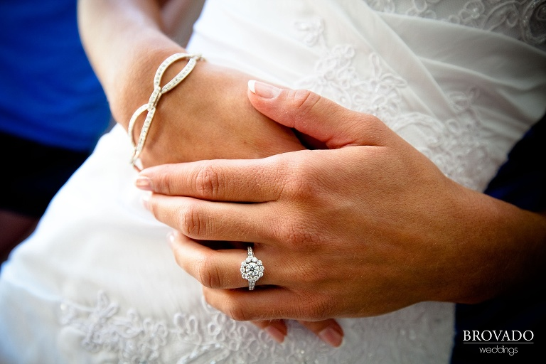 close up photograph of bride showing off her wedding ring