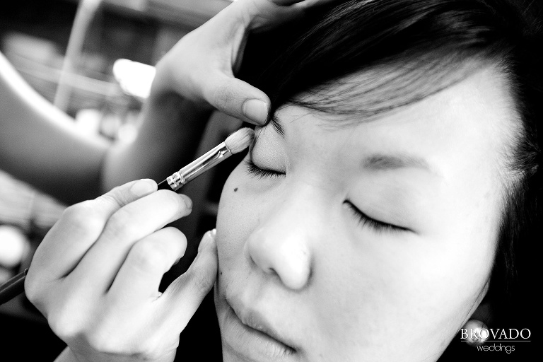 close up black and white photograph of bride getting her makeup done