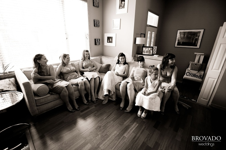 sepia photograph of bride and bridesmaids relaxing before ceremony