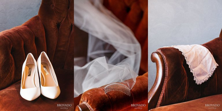 White bridal details against velvet and leather armchair