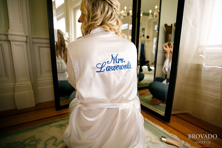 Brooke wearing a robe embroidered with her new last name