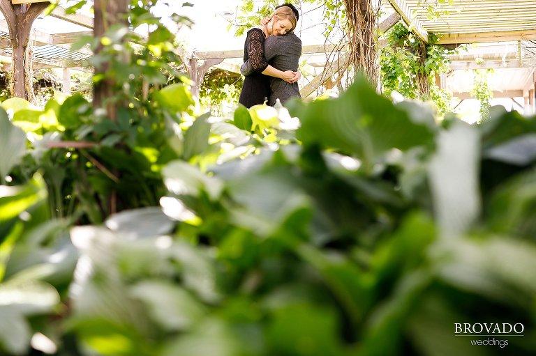 Ajit and Jenna hugging in greenhouse
