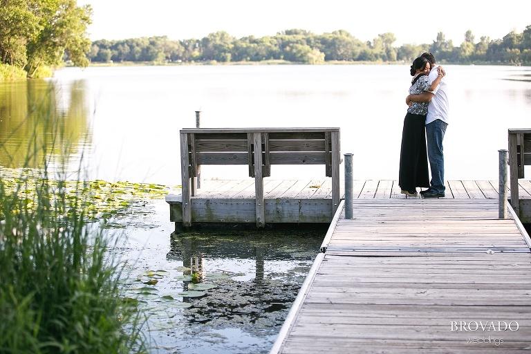 engaged couple embracing on lakeside