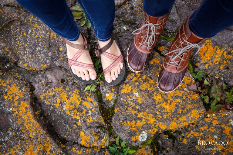 Closeup of brides hiking boots and chacos