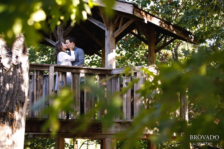 Engaged couple Hannah and Jason kissing in a treehouse