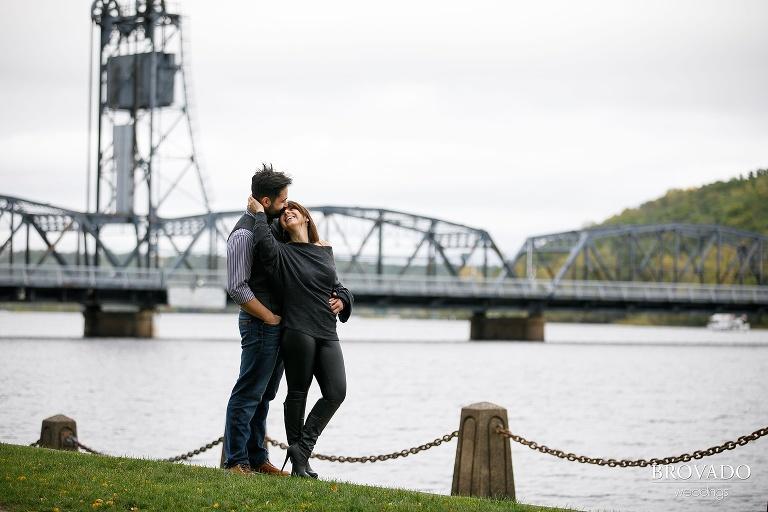 Yevgenia and Eugene standing in front of Stillwater lift bridge