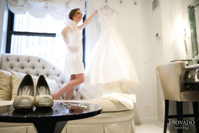 Megan posing with her wedding dress
