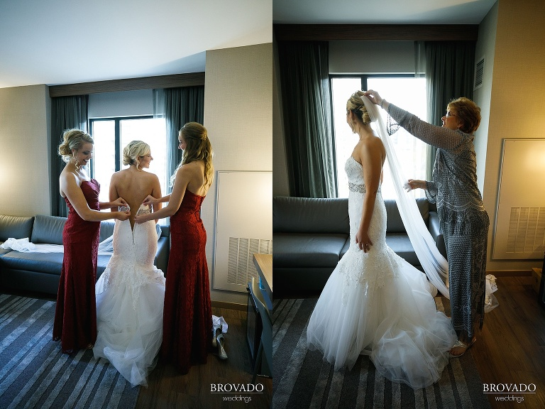 Hannah's bridesmaids and mother helping her get dressed