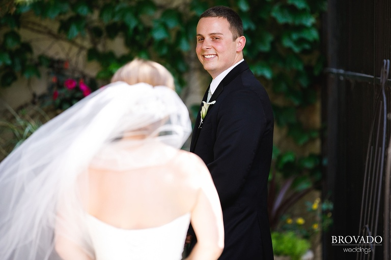 groom smiling during first look