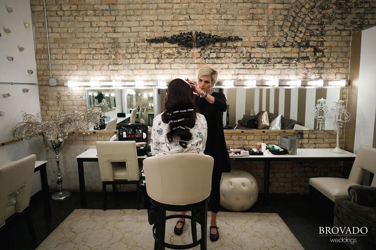 Bride Yevgenia having her makeup done