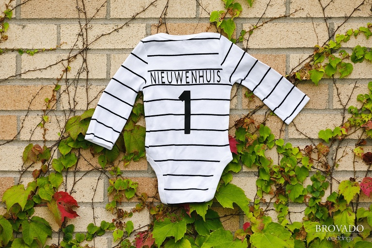 Newborn jersey with the number 1 on it