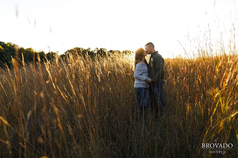 golden hour engagement photo in field
