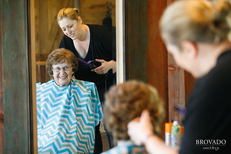 Grandmother of the bride getting her hair styled for wedding